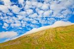 Dramatic puffy clouds over the tundra summit of Round Island, Walrus Islands State Game Sanctuary, Bristol Bay, Alaska, USA, July, AK_Round_Island-518