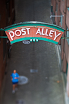 Sign marking the lower entrance to Post Alley near the historic Pike Place Market, Seattle, Washington State, USA, Post_Alley-4
