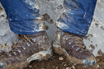 Extremely muddy hiking boots and rain pants from the wet clay soil along the trail to Og Pass through Og Meadows; Mount Assiniboine Provincial Park, British Columbia, Canada, Mount_Assiniboine_Hikers-1