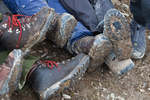 Extremely muddy hiking boots and rain pants from the wet clay soil along the trail to Og Pass through Og Meadows; Mount Assiniboine Provincial Park, British Columbia, Canada, Mount_Assiniboine_Hikers-8