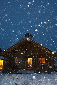 Mount Assiniboine Lodge in snowstorm at twilight, warmly lit for guests, Mount Assiniboine Provincial Park, British Columbia, Canada, Mount_Assiniboine_Lodge-31