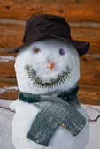 "Snowman (snowwoman) named ""Hippy Chick,"" on the porch of one of the Naiset Huts; Mount Assiniboine Provincial Park, British Columbia, Canada, Mount_Assiniboine_Snowman-3"