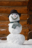 "Snowman (snowwoman) named ""Hippy Chick,"" on the porch of the Forget-Me-Not Hut, one of the Naiset Huts near Mount Assiniboine Lodge; Mount Assiniboine Provincial Park, British Columbia, Canada, Mount_Assiniboine_Snowman-4"