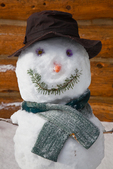 "Snowman (snowwoman) named ""Hippy Chick,"" on the porch of the Forget-Me-Not Hut, one of the Naiset Huts near Mount Assiniboine Lodge; Mount Assiniboine Provincial Park, British Columbia, Canada, Mount_Assiniboine_Snowman-5"