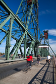 Bicycle commuters crossing the Hawthorne Bridge in downtown Portland, Oregon, USA, Portland_Downtown-23 [Photographer's Note: the people and/or places in this photograph are not model or property released, meaning that the photo may be licensed for editorial applications only-no commercial use]