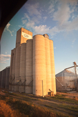 Big concrete grain elevator in Montana, viewed from the Amtrak Empire Builder in late afternoon sunlight, USA, Empire_Builder-296  [Note: NOT property released; editorial use only]