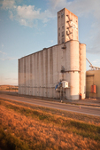 Big concrete grain elevator in Montana, viewed from the Amtrak Empire Builder in late afternoon sunlight, USA, Empire_Builder-297  [Note: NOT property released; editorial use only]