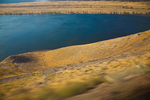 Following the great Columbia River in eastern Washington State, viewed from the Amtrak Empire Builder, with foreground motion blur due to the moving train, USA, Empire_Builder-366