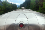 Looking back at some BNSF private railroad passenger cars being towed by an Amtrak locomotive through the Cascade Mountains of Washington State, viewed from the Amtrak Empire Builder, USA, Empire_Builder-410