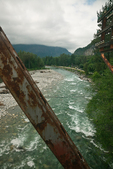 Crossing the Skykomish River in the Cascade Mountains of Washington State on a steel railroad bridge, viewed from the Amtrak Empire Builder, USA, Empire_Builder-432