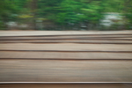 Railroad tracks through the Cascade Mountains of Washington State, viewed from the Amtrak Empire Builder, with foreground motion blur due to the moving train, USA, Empire_Builder-440