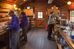 Interior of the Elizabeth Parker Hut in the Lake O'Hara area of Yoho National Park, where members of the Seattle-based Mountaineers are preparing breakfast, during one of the days of their stay, British Columbia, Canada, Elizabeth_Parker_Hut-10 [Note: No model releases available; for careful editorial use only]