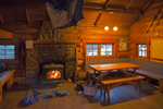 Interior of the Elizabeth Parker Hut, with wood fire blazing and drying out gear, in the Lake O'Hara area of Yoho National Park, British Columbia, Canada, Elizabeth_Parker_Hut-20
