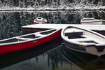 Red canoes and rowboats, dusted with fresh overnight snow, on the tranquil surface of Lake O'Hara at a dock for guests of Lake O'Hara Lodge, Yoho National Park, British Columbia, Canada, Yoho_Lake_OHara_Lodge-32