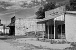 Abandoned commercial buildings on the main street of Whitman, a dying ranching town in the Nebraska sandhills, Nebraska, USA.