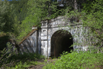 West entrance to the First Cascade Tunnel for the now-abandoned high route of the Great Northern Railway over Stevens Pass; now this tunnel portal is seen at the east end of the Iron Goat Trail, Mt. Baker - Snoqualmie National Forest, Cascade Mountains, Washington State, USA.