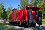 Refurbished Great Northern Railway caboose at Iron Goat Trail Interpretive Site and trailhead near Stevens Pass, Mt. Baker - Snoqualmie National Forest, Cascade Mountains, Washington State, USA.