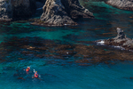 Sea kayakers in Cathedral Cove viewed from a high point on East Anacapa Island, Channel Islands National Park, Callifornia, USA