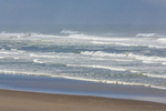 Waves of the Pacific Ocean rolling in on sandy beach at Siltcoos Recreation Area, part of Oregon Dunes National Recreation Area along the Oregon Coast, Siuslaw National Forest,  USA