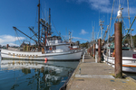 Commercial fishing boats moored in the Port of Newport commercial marina, Yaquina Bay and City of Newport along the Oregon Coast, USA [NOTE: No property releases exist for these vessels, so licensing is available for editorial uses only]
