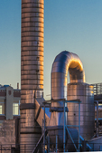Seattle Steam Co. pipes and smokestack atop their building on the Seattle waterfront; Seattle Steam is a district energy system providing heat to 191 customers, Seattle, Washington State USA [No property release; licensing for editorial use only]