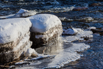 Ice formations along the edge of the Muskegon River during a long period of below freezing temperatures, Big Rapids, Michigan, USA