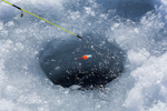 Ice fishing for panfish in a hole on a lake in central Michigan, USA