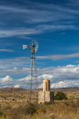 Windmill and tank providing water supply in City of Rocks State Park, located between Silver City and Deming in the Chihuahuan Desert, New Mexico, USA
