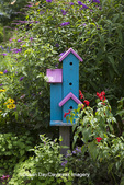 63821-23017 Blue and pink birdhouse in flower garden, Marion Co., IL