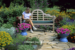 63821-078.20 Woman reading on Bench in Bird & Butterfly Flower Garden  Marion Co.  IL