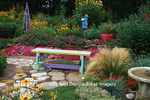 63821-185.18 Rainbow bench, obelisk, bird bath, and birdhouse in flower garden, Marion Co. IL