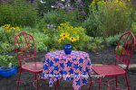 63821-23203 Flower garden with red table and chairs, blue pots, Marion Co, IL (PR)