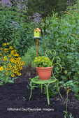 63821-23415 Flower garden with green chair and birdhouse Marion Co., IL (PR)