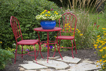 63821-23513 Red table & chairs with blue pot in flower garden.  Marion Co., IL (PR)