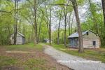 63895-15815 Cabins at Log Cabin Village in spring Kinmundy IL
