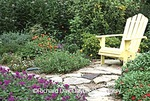 63821-14201 Yellow Adirondack chair in flower garden, Marion County, IL