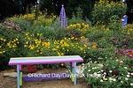 63821-18509 Rainbow bench, obelisk, and birdhouse in flower garden, Marion Co. IL
