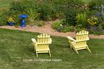 63821-20007 Yellow Adirondack chairs near flower garden with blue birdbath, Marion Co., IL