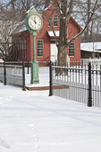 63995-00804 Old clock and church in winter in Billie Creek Village, Rockville IN