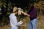 01715-01820 Man and woman inspecting/monitoring nest box (bluebird, chickadee, titmouse, swallow)  Marion Co.  IL