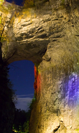 "Natural Bridge, colorful night light floodlit musical show with booming voice gives spiritual religious message ""Drama of Creation"" , visitors see the show from both sides of the arch and lasts about 45 minutes, sedimentary rock; limestone, water erosion, Virginia, USA; NaturalBridgeD3B8021_ARS.CR2"