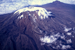 """Mount Kilimanjaro is Africa's tallest mountain peak. It is a stratovolcano with three distinct cones of volcanic cone Kibo, volcanic cone Mawenzi, volcanic cone Shira. While Kilimanjaro appears to be dormant volcanically, the response of the top of the mountain to global climate change draws global attention. There has been marked retreat of the glaciers, with the most recent ice cap volume dropping by more than 80%. environment. In recent usage, especially in the context of environmental policy, climate change usually refers to changes in modern climate. It may be qualified as anthropogenic climate change, more generally known as """"global warming"""" or """"anthropogenic global warming"""" or AGW, caused by the activities of modern humans. Of most concern in these anthropogenic factors is the increase in CO2 levels due to emissions from fossil fuel combustion, followed by aerosols (particulate matter in the atmosphere) and cement manufacture. Other factors, including land use, ozone depletion, animal agriculture and deforestation, are also of concern in the roles they play, both separately and in conjunction with other factors, in affecting climate, microclimate, and measures of climate variables. pollution, pollute, polluted; air pollution, greenhouse gases, carbon dioxide; global climate change, global warming,  East Africa, Tanzania,  Africa, MountKilimanjaro8394_001DzWS_ARS.jpg"""