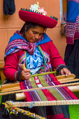 "Chinchero weavers, unique boarder technique called ñawi awapa, Luraypu, doble cara, Chinchero lliklla, traditional blankets, indigo blue, cochineal red, and ch'ilka green. Luraypu, Natural Dyes used by Chinchinero weavers: Chilca , Baccharis latifolia Family: Asteraceae, green dye. Chillca in Quechua, Chilca, chilca black, white chilca; ch'illka in Quechua; Chilean romerillo; flowers from a bush called Qolle to make a golden yellow; copper sulfate from above Accha Alta to add to the flowers to make green; shapy, a vine from the jungle just over the mountain beyond Accha Alta, for pink; cochineal, the insect which feeds on cactus, for purple; and citric acid and alum to bump the cochineal dye solution to red. Kiko (flowers), Bidens andicola, Yellows; Qaqa Sunka, ""beard lichen"", Usnea barbata a lichen with Usnic acid; Dark blues; Indigo, Indigo suffruticosa; Purple Corn, purple dye; Chinchero, Andes Mountains; Chinchero or Chincheros, Chinchero or Chincheros has Inca ruins and a well-conserved medieval Spanish look. The town is one of the most beautiful ones in the Cuzco area. Chinchero is not in the Sacred Valley, but is close to it. The height from sea level of this town is 3762 m in the Andes Mountains so it is even higher than Cusco. There are Inca walls and old colonial Roman-Catholic churches. Some house walls are partly of Inca origin. The Inca influence makes Chincheros streets resemble Cuzco. Lots of traditional culture including the famous Chinchero weavers. Chinchero was the 'birthplace of the rainbow.' Located 45 minutes outside of Cusco on the high plain Pampa de Anta, Chinchero looks out on stunning views where rainbows frequently arch across potato fields during the rainy season. The colours of the rainbow can also be found throughout Chinchero textiles. The 40 adult weavers and 40 children of the community weaving association are masters in the textile art. Chinchero weavers traditionally weave in the doble cara, or two sided warp-faced, technique. Beginning in the 20th century weavers began to learn ley, or single-sided supplementary warp technique, as well as new designs from other communities. Today Chinchero weavers only create traditional textiles in the traditional techniques and designs of Chinchero, while they will utilize a variety of designs and techniques for other types of textiles. Chinchero lliklla, or traditional blankets, have a wide section of blue, red and/or green plain weave and symmetrical sections of designs. When natural indigo dye disappeared in the 20th century, many weavers chose to weave the traditionally blue plain weave section in black. For this reason, many Chinchero blankets from the early to mid 20th century have black plain weave rather than blue. Today the weavers of Chinchero have recovered natural dying and once more weave their plain-weave section in indigo blue, cochineal red, and ch'ilka green. Luraypu is the main design of the community and figures in the center of design strips with smaller designs to either side. Chinchero weavers are particularly proud of their unique boarder technique called ñawi awapa which is simultaneous woven and sewn onto the edges of textiles. In this technique the weft of the border weaving is also the thread used to sew the border onto the textile. (from weavers website); Peru, South America, Peru40940r.TIF"