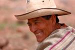 farmer, happy, smiling, smile, granger; farmhand, farm hand, field hand, farming; potato; cooking in earth earthen oven, Maras; Andes Mountains; Peru, South America, PERU23291czs.tif