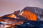 Longs Peak, 14,259 feet elevation, Alpenglow, Alpenglühen; sunrise, daybreak, dawn, sun up; in Winter, wintertime; snow, snowstorm, snowflakes can have extreme weather winds, cold etc. ; part of the northern Front Range and only peak over 14,000 ft in Rocky Mountain National Park, Colorado, USA; RMD3B9106zns.tif