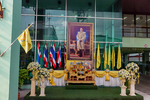 "Memorial and respect for death of King Bhumibol Adulyadej. ""Thailand's King Bhumibol Adulyadej was the superlative monarch. He was the world's longest-reigning, the world's richest and, among his own subjects at least, the world's most adored. Throughout his 70 years on the throne, Bhumibol has been credited with staving off numerous catastrophes through intelligence, fortitude and his love of country. Bhumibol's body will rest in Bangkok's spired Grand Palace in a golden urn, draped in silk, gold and diamonds, for an official grieving period of one year, as Brahmin priests and Buddhist monks, wreathed in incense smoke, chant incantations."" Sanctuary of Truth is a religious construction in Pattaya, Thailand. The sanctuary is an all-wood building filled with sculptures based on traditional Buddhist and Hindu motifs. The top of the building is 105 meters high, and the building covers an area of more than two rai. It features contemporary Visionary art based on traditional religious themes. The project was initiated as an idea of Thai businessman Lek Viriyaphant in 1981, and is scheduled to be completed in 2050. Made entirely of wood (without any metal nails) and commanding a celestial view of the ocean, the Sanctuary of Truth is best described as a visionary environment: part art installation, religious shrine and cultural monument. Constructed in four wings dedicated to Thai, Khmer, Chinese and Indian religious iconography, its architecture and setting is impressive. Pattaya, Thailand, Asia; Pacific Rim; THAI048090zs.jpg"