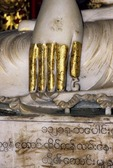 GILDED FINGERS OF AN EARTH-TOUCHING BUDDHA, SHWEDAGON PAGODA, RANGOON, BURMA