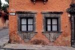 WINDOWS IN A COLORFUL WALL, SAN MIGUEL DE ALLENDE, GUANAJUATO, MEXICO
