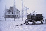 RANCH HOUSE, STARMILL WINDMILL & CHUCKWAGON IN SNOW, HIGH PLAINS, TEXAS