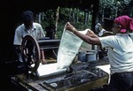 PRESSING SHEET LATEX TO REMOVE EXCESS WATER BEFORE DRYING, MALAYSIA